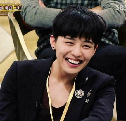 Male K-Pop Idols with Adorable 'Cave Mouth Smiles'